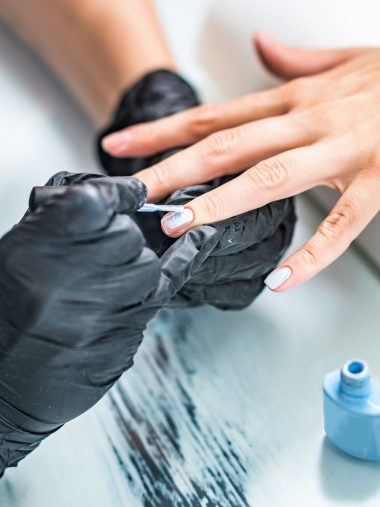Manicuring nails in beauty salon