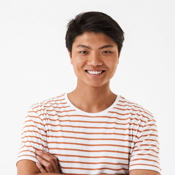 portrait-of-a-happy-young-asian-man-SCV4HD8