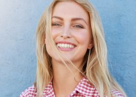 cheerful-young-woman-looking-at-camera-and-PX5UHQ2