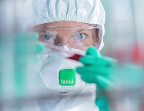 Virologist healthcare professional analyzing blood test sample in lab tubes, close up of medical worker working, selective focus