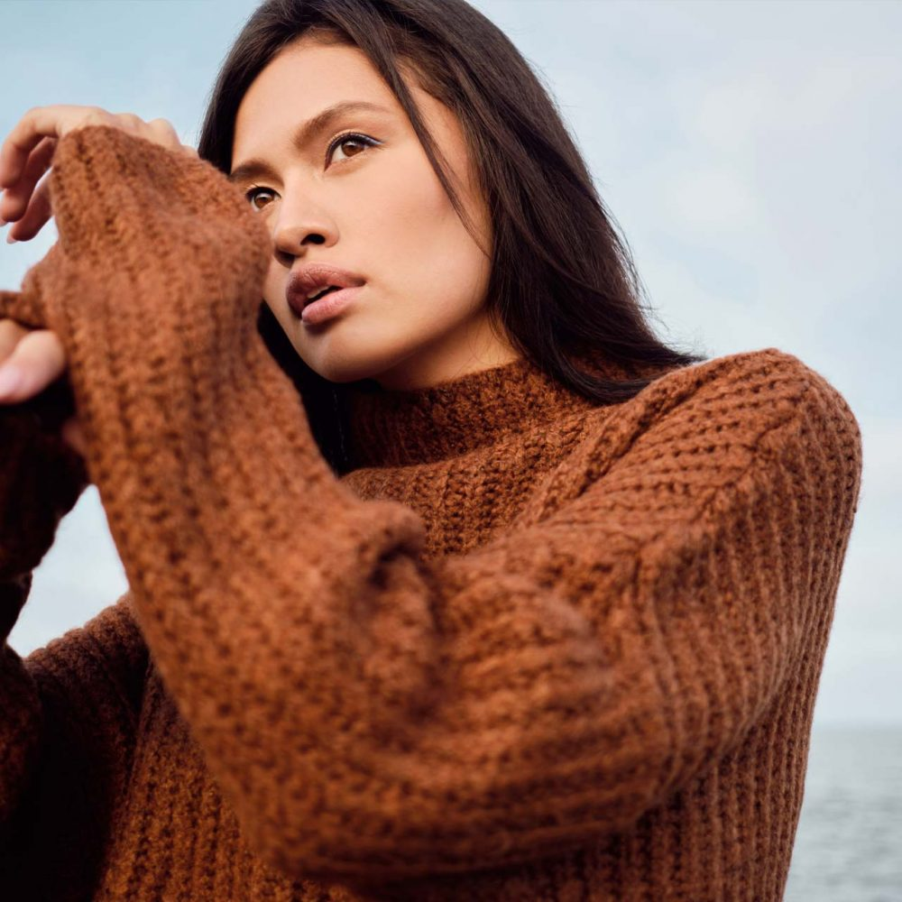 beautiful-asian-brunette-girl-in-cozy-knitted-JXDH6Q7