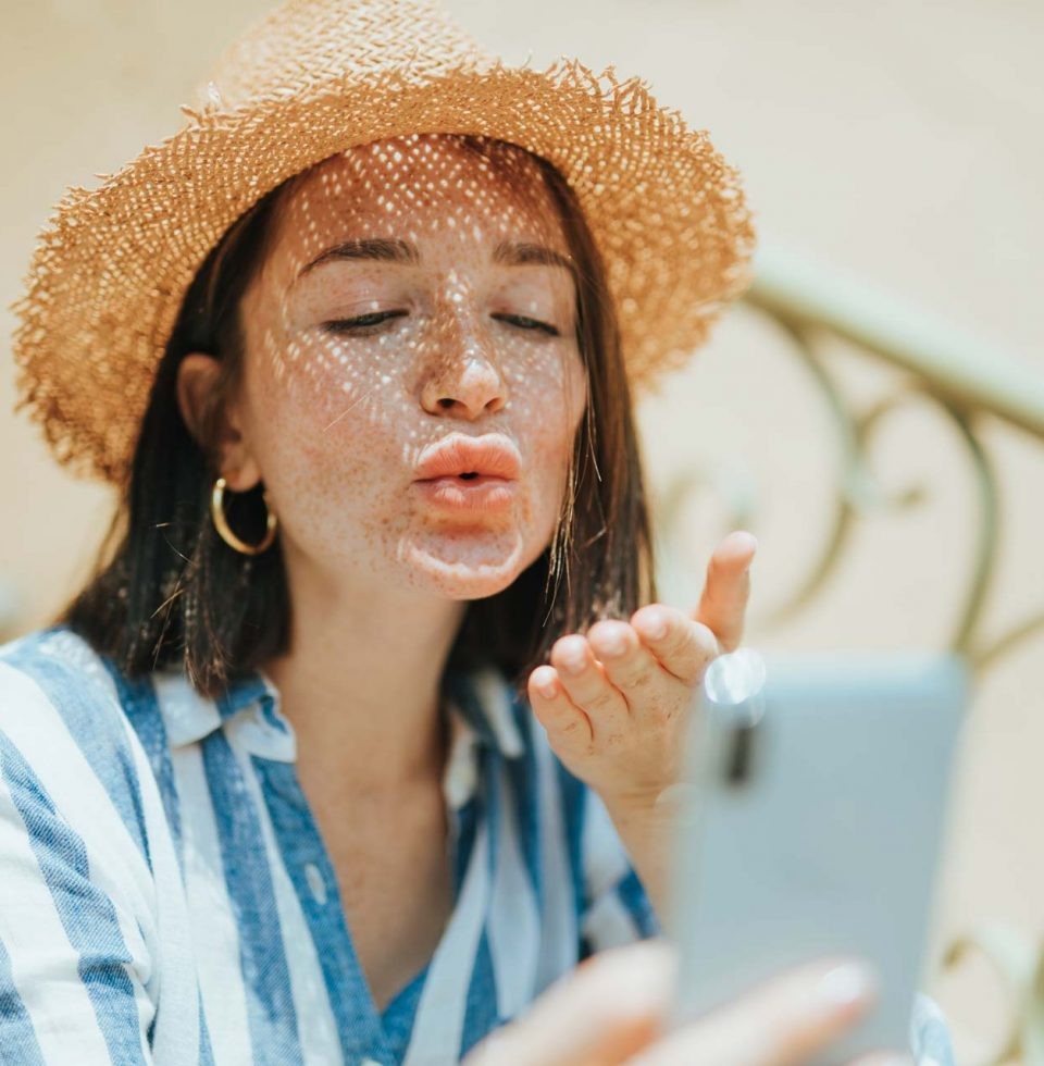 woman-making-a-video-call-from-her-phone-J8L7AKF