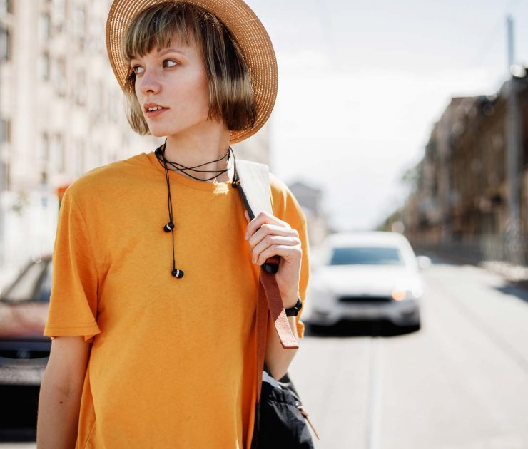 young-girl-with-headphones-in-a-yellow-t-shirt-FAKBSYC