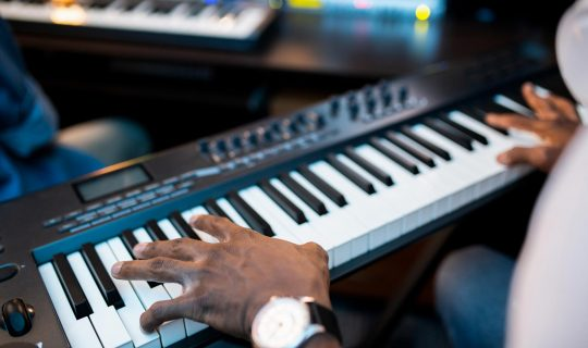 hands-of-young-african-composers-or-musician-touch-YJN5GHX