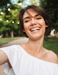 smiling-young-girl-taking-a-selfie-NR2ZWMP