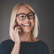 laughing-busineswoman-talking-on-her-cellphone-9K4LH7Z